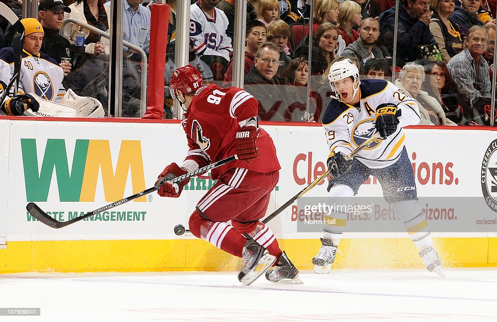 <a gi-track='captionPersonalityLinkClicked' href=/galleries/search?phrase=Jason+Pominville&family=editorial&specificpeople=570525 ng-click='$event.stopPropagation()'>Jason Pominville</a> #29 of the Buffalo Sabres tries to get the puck pass the puck around <a gi-track='captionPersonalityLinkClicked' href=/galleries/search?phrase=Kyle+Turris&family=editorial&specificpeople=4251834 ng-click='$event.stopPropagation()'>Kyle Turris</a> #91 of the Phoenix Coyotes on January 8, 2011 at Jobing.com Arena in Glendale, Arizona.