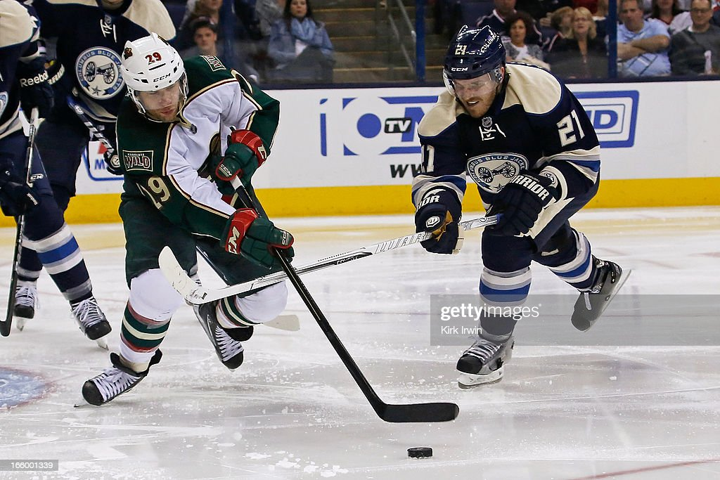 Jason Pominville #29 of the Minnesota Wild and James Wisniewski #21 of the Columbus Blue Jackets battle for control of a loose puck during the third period on April 7, 2013 at Nationwide Arena in Columbus, Ohio. Minnesota defeated Columbus 3-0.