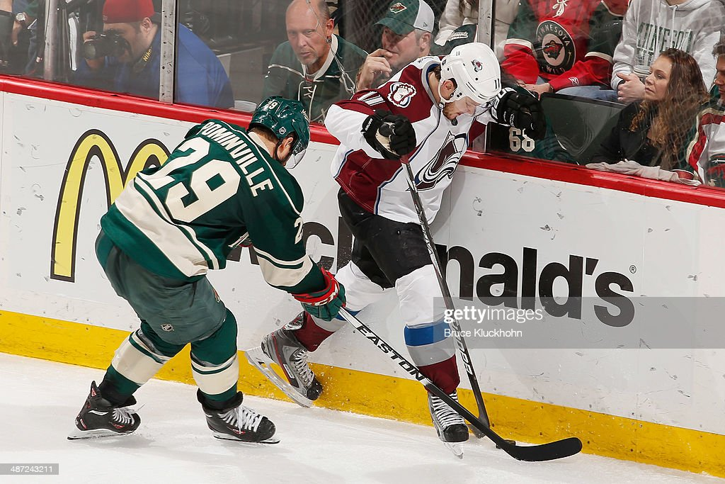 Jason Pominville #29 of the Minnesota Wild and Jamie McGinn #11 of the Colorado Avalanche battle for the puck along the boards during Game Six of the First Round of the 2014 Stanley Cup Playoffs on April 28, 2014 at the Xcel Energy Center in St. Paul, Minnesota.