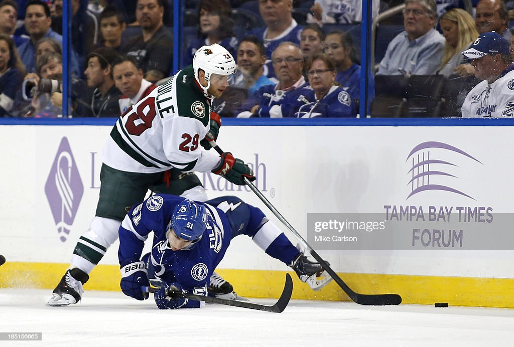 <a gi-track='captionPersonalityLinkClicked' href=/galleries/search?phrase=Jason+Pominville&family=editorial&specificpeople=570525 ng-click='$event.stopPropagation()'>Jason Pominville</a> #29 of the Minnesota Wild battles for the puck with <a gi-track='captionPersonalityLinkClicked' href=/galleries/search?phrase=Valtteri+Filppula&family=editorial&specificpeople=2234404 ng-click='$event.stopPropagation()'>Valtteri Filppula</a> #51 of the Tampa Bay Lightning at the Tampa Bay Times Forum on October 17, 2013 in Tampa, Florida.