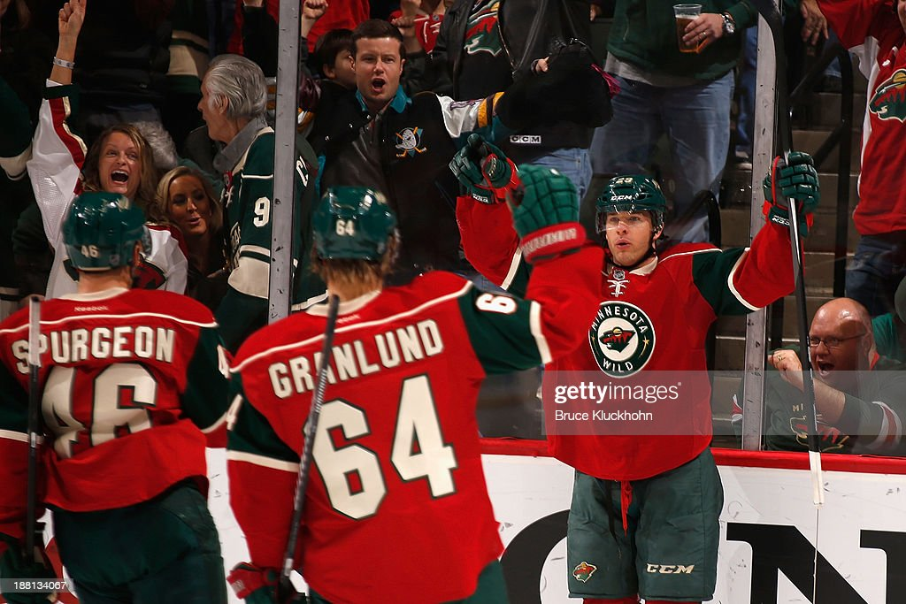 <a gi-track='captionPersonalityLinkClicked' href=/galleries/search?phrase=Jason+Pominville&family=editorial&specificpeople=570525 ng-click='$event.stopPropagation()'>Jason Pominville</a> #29 of the Minnesota Wild celebrates a goal with Mikael Granlund #64 and Jared Spurgeon #46 in the first period against the Florida Panthers during the game on November 15, 2013 at the Xcel Energy Center in St. Paul, Minnesota.