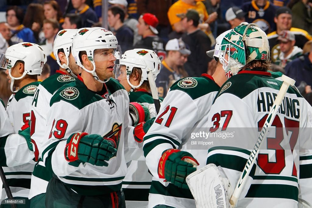 <a gi-track='captionPersonalityLinkClicked' href=/galleries/search?phrase=Jason+Pominville&family=editorial&specificpeople=570525 ng-click='$event.stopPropagation()'>Jason Pominville</a> #29 of the Minnesota Wild celebrates their 2-1 win against the Buffalo Sabres with goaltender <a gi-track='captionPersonalityLinkClicked' href=/galleries/search?phrase=Josh+Harding&family=editorial&specificpeople=700587 ng-click='$event.stopPropagation()'>Josh Harding</a> #37 on October 14, 2013 at the First Niagara Center in Buffalo, New York.