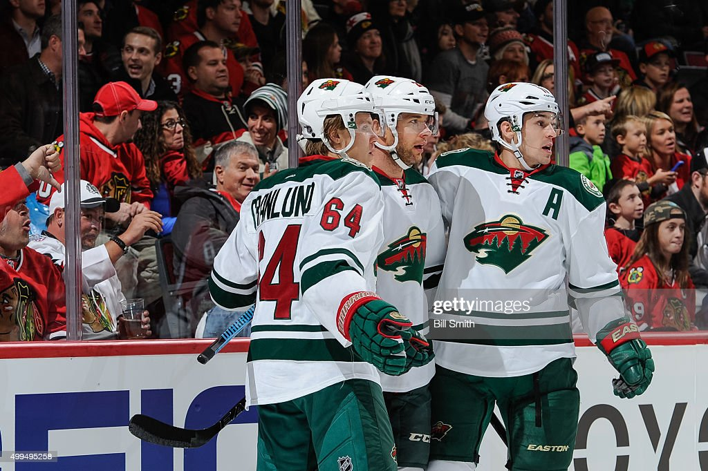 <a gi-track='captionPersonalityLinkClicked' href=/galleries/search?phrase=Jason+Pominville&family=editorial&specificpeople=570525 ng-click='$event.stopPropagation()'>Jason Pominville</a> #29 of the Minnesota Wild (middle) celebrates with <a gi-track='captionPersonalityLinkClicked' href=/galleries/search?phrase=Mikael+Granlund&family=editorial&specificpeople=5649678 ng-click='$event.stopPropagation()'>Mikael Granlund</a> #64 and <a gi-track='captionPersonalityLinkClicked' href=/galleries/search?phrase=Zach+Parise&family=editorial&specificpeople=213606 ng-click='$event.stopPropagation()'>Zach Parise</a> #11 after scoring against the Chicago Blackhawks in the first period of the NHL game at the United Center on December 1, 2015 in Chicago, Illinois.