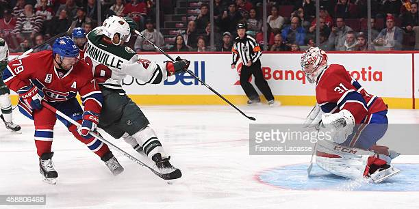 Jason Pominville of the Minnesota Wild fire a shot against Carey Price of the Montreal Canadiens in the NHL game at the Bell Centre on November 8...