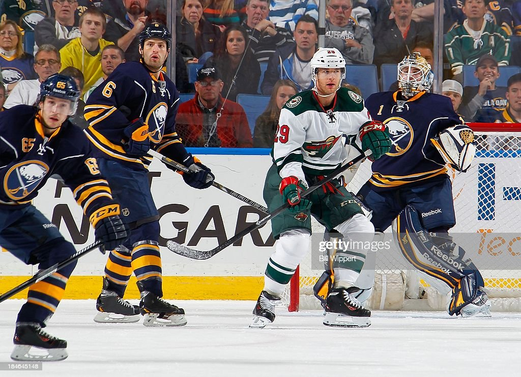 <a gi-track='captionPersonalityLinkClicked' href=/galleries/search?phrase=Jason+Pominville&family=editorial&specificpeople=570525 ng-click='$event.stopPropagation()'>Jason Pominville</a> #29 of the Minnesota Wild gets in position between Brian Flynn #65, Mike Weber #6 and <a gi-track='captionPersonalityLinkClicked' href=/galleries/search?phrase=Jhonas+Enroth&family=editorial&specificpeople=570456 ng-click='$event.stopPropagation()'>Jhonas Enroth</a> #1 of the Buffalo Sabres on October 14, 2013 at the First Niagara Center in Buffalo, New York. Minnesota won, 2-1.