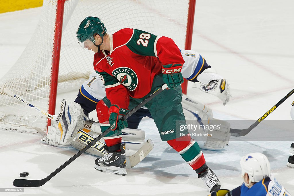 <a gi-track='captionPersonalityLinkClicked' href=/galleries/search?phrase=Jason+Pominville&family=editorial&specificpeople=570525 ng-click='$event.stopPropagation()'>Jason Pominville</a> #29 of the Minnesota Wild handles the puck as goalie <a gi-track='captionPersonalityLinkClicked' href=/galleries/search?phrase=Brian+Elliott&family=editorial&specificpeople=687032 ng-click='$event.stopPropagation()'>Brian Elliott</a> #1 of the St. Louis Blues defends during the game on April 11, 2013 at the Xcel Energy Center in Saint Paul, Minnesota.