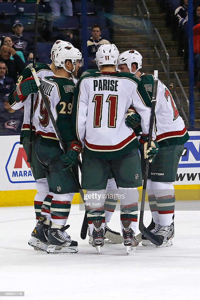 <a gi-track='captionPersonalityLinkClicked' href=/galleries/search?phrase=Jason+Pominville&family=editorial&specificpeople=570525 ng-click='$event.stopPropagation()'>Jason Pominville</a> #29 of the Minnesota Wild is congratulated by his teammates after scoring his first goal with the Wild during the third period against the Columbus Blue Jackets on April 7, 2013 at Nationwide Arena in Columbus, Ohio. Minnesota defeated Columbus 3-0.
