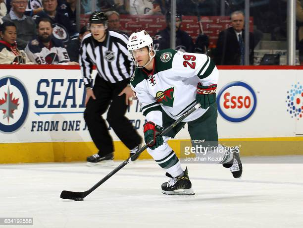 Jason Pominville of the Minnesota Wild plays the puck down the ice during first period action against the Winnipeg Jets at the MTS Centre on February...