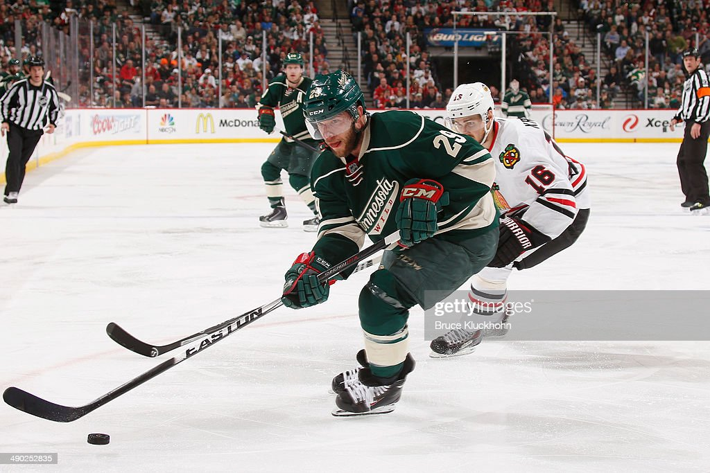 Jason Pominville #29 of the Minnesota Wild skates with the puck while Marcus Kruger #16 of the Chicago Blackhawks defends during Game Six of the Second Round of the 2014 Stanley Cup Playoffs on May 13, 2014 at the Xcel Energy Center in St. Paul, Minnesota.