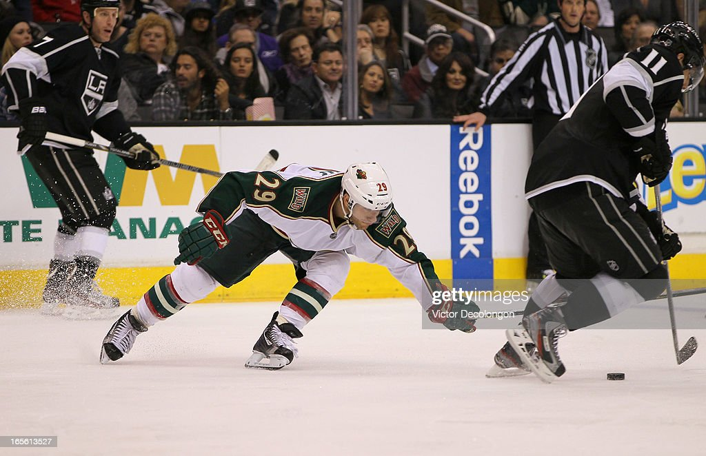 <a gi-track='captionPersonalityLinkClicked' href=/galleries/search?phrase=Jason+Pominville&family=editorial&specificpeople=570525 ng-click='$event.stopPropagation()'>Jason Pominville</a> #29 of the Minnesota Wild swipes at the puck with his stick as <a gi-track='captionPersonalityLinkClicked' href=/galleries/search?phrase=Anze+Kopitar&family=editorial&specificpeople=634911 ng-click='$event.stopPropagation()'>Anze Kopitar</a> #11 of the Los Angeles Kings tries to skate the puck out of the defensive zone during the third period of their NHL game at Staples Center on April 4, 2013 in Los Angeles, California. The Kings defeated the Wild 3-0.