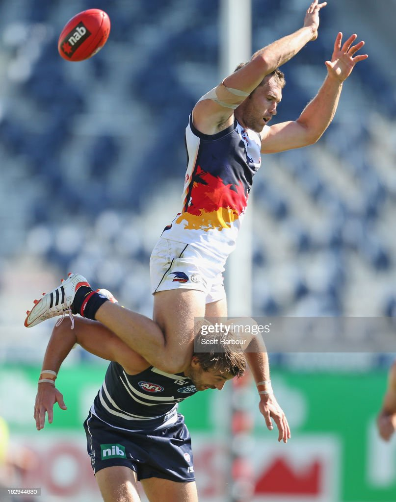 Jason Porplyzia of the Crows attempts to take a mark on the shoulders of <a gi-track='captionPersonalityLinkClicked' href=/galleries/search?phrase=Corey+Enright&family=editorial&specificpeople=247703 ng-click='$event.stopPropagation()'>Corey Enright</a> of the Cats during the round two AFL NAB Cup match between the Geelong Cats and the Adelaide Crows at Simonds Stadium on March 2, 2013 in Geelong, Australia.