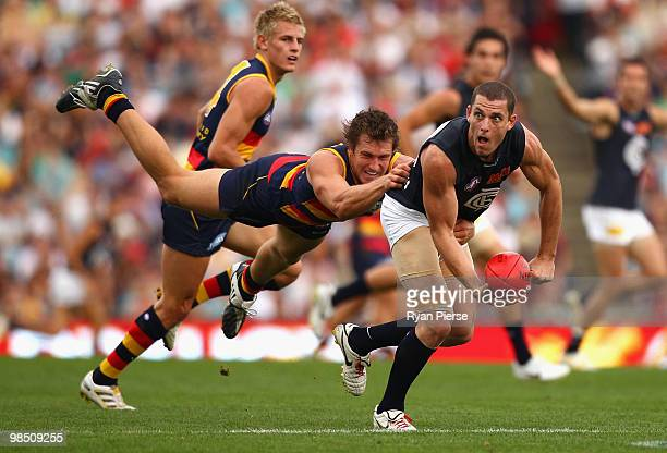 Jason Porplyzia of the Crows tackles Heath Scotland of the Blues during the round four AFL match between the Adelaide Crows and the Carlton Blues at...