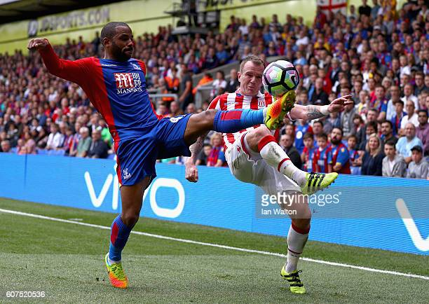 Jason Puncheon of Crystal Palace and Glenn Whelan of Stoke City battle to control the ball during the Premier League match between Crystal Palace and...