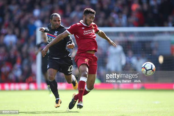 Jason Puncheon of Crystal Palace and Joe Gomez of Liverpool during the Premier League match between Liverpool and Crystal Palace at Anfield on August...
