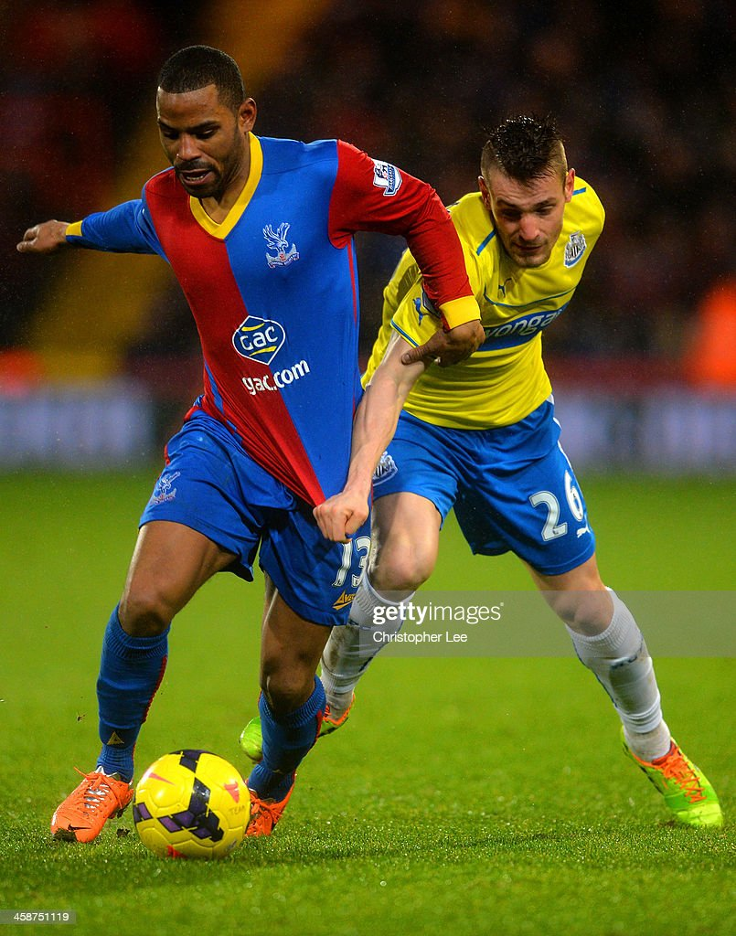Jason Puncheon of Crystal Palace and <a gi-track='captionPersonalityLinkClicked' href=/galleries/search?phrase=Mathieu+Debuchy&family=editorial&specificpeople=729104 ng-click='$event.stopPropagation()'>Mathieu Debuchy</a> of Newcastle United compete for the ball during the Barclays Premier League match between Crystal Palace and Newcastle United and Selhurst Park on December 21, 2013 in London, England.