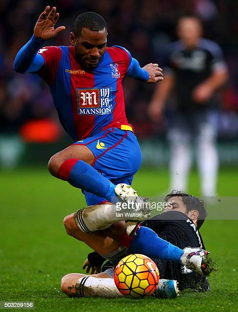 Jason Puncheon of Crystal Palace battles for the ball with Cesc Fabregas of Chelsea during the Barclays Premier League match between Crystal Palace...