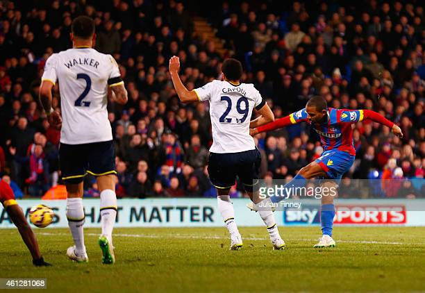 Jason Puncheon of Crystal Palace beats Etienne Capoue of Spurs to score their second goal during the Barclays Premier League match between Crystal...