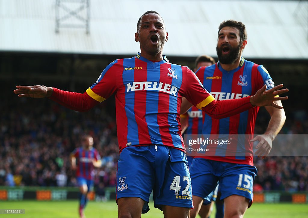 Jason Puncheon of Crystal Palace celebrates his team's first goal with Mile Jedinak during the Barclays Premier League match between Crystal Palace and Manchester United at Selhurst Park on May 9, 2015 in London, England.
