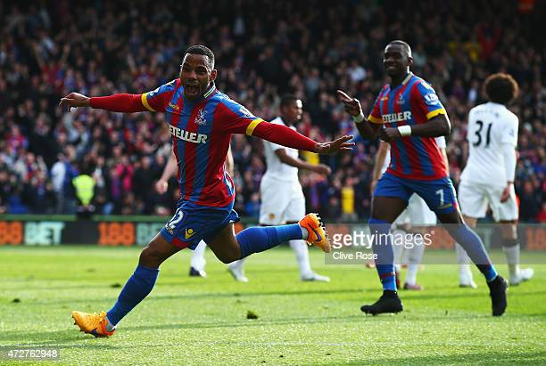 Jason Puncheon of Crystal Palace celebrates his team's first goal with Yannick Bolasie during the Barclays Premier League match between Crystal...