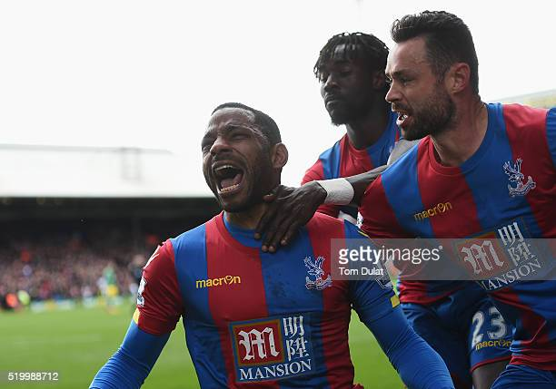 Jason Puncheon of Crystal Palace celebrates scoring his team's first goal with his team mates during the Barclays Premier League match between...