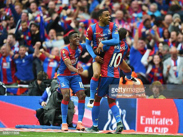 Jason Puncheon of Crystal Palace celebrates scoring his team's first goal with his team mates Yannick Bolasie and Wilfried Zaha during The Emirates...