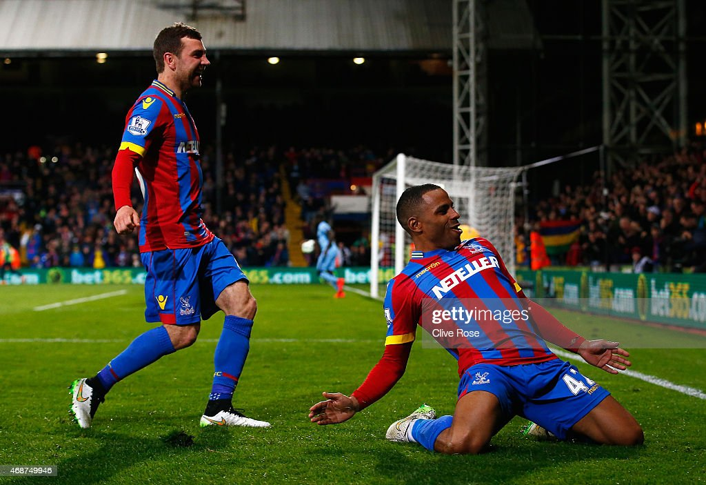 Jason Puncheon (R) of Crystal Palace celebrates scoring his team's second goal during the Barclays Premier League match between Crystal Palace and Manchester City at Selhurst Park on April 6, 2015 in London, England.