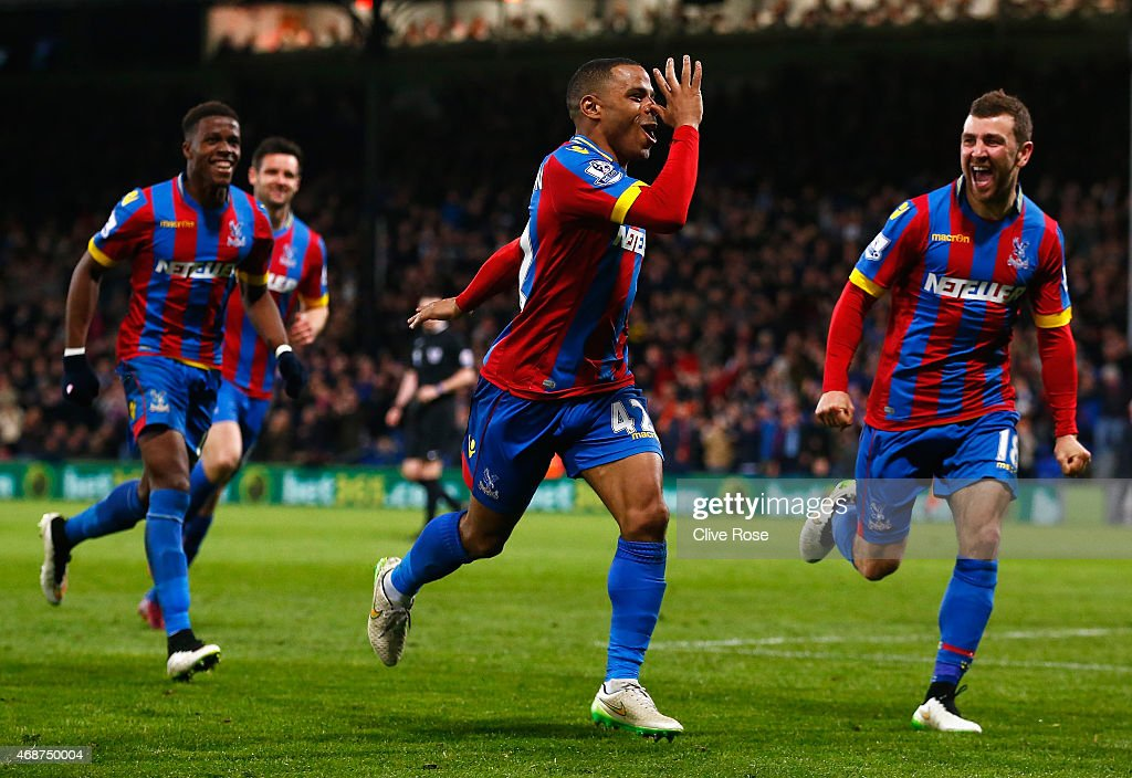Jason Puncheon (C) of Crystal Palace celebrates scoring his team's second goal with team mates during the Barclays Premier League match between Crystal Palace and Manchester City at Selhurst Park on April 6, 2015 in London, England.