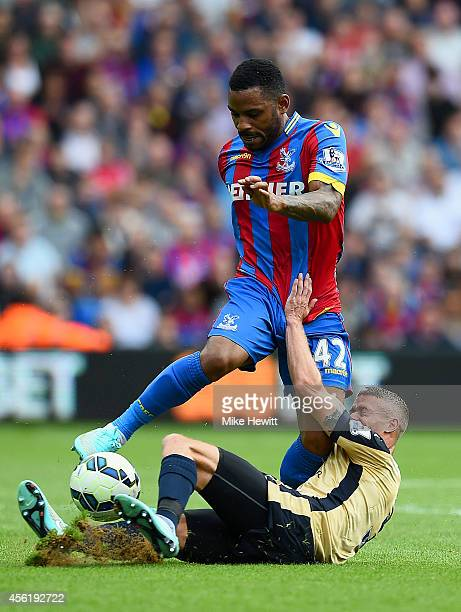 Jason Puncheon of Crystal Palace in action against Paul Konchesky of Leicester City during the Barclays Premier League match between Crystal Palace...
