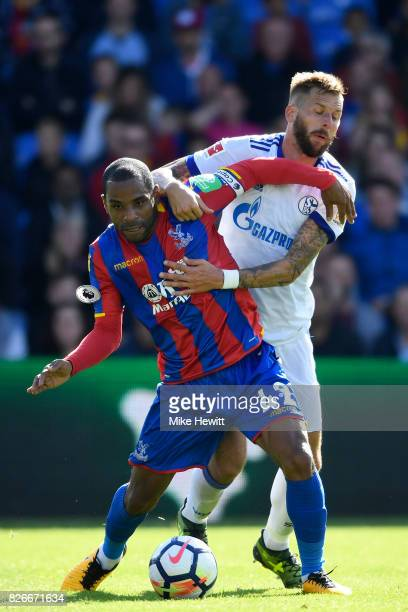 Jason Puncheon of Crystal Palace is challenged by Guido Burgstaller of Schalke during a Pre Season Friendly between Crystal Palace and FC Schalke 04...