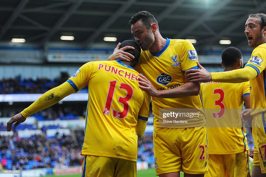 Jason Puncheon #13 of Crystal Palace is congratulated by teammate Damien Delaney after scoring his team's third goal during the Barclays Premier League match between Cardiff City and Crystal Palace at Cardiff City Stadium on April 5, 2014 in Cardiff, Wales.