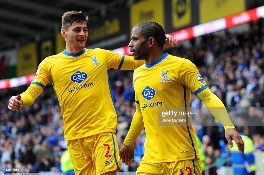 Jason Puncheon (R) of Crystal Palace is congratulated by teammate Joel Ward after scoring his team's third goal during the Barclays Premier League match between Cardiff City and Crystal Palace at Cardiff City Stadium on April 5, 2014 in Cardiff, Wales.