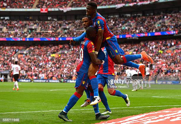 Jason Puncheon of Crystal Palace is mobbed my team mates in celebration as he scores their first goal during The Emirates FA Cup Final match between...