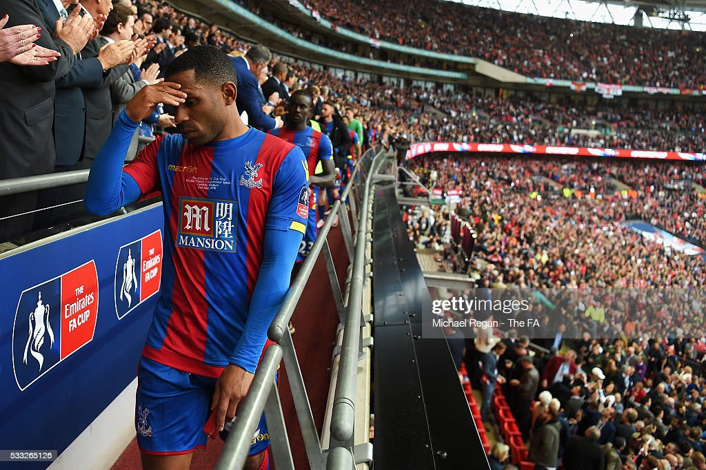 <a gi-track='captionPersonalityLinkClicked' href=/galleries/search?phrase=Jason+Puncheon&family=editorial&specificpeople=747694 ng-click='$event.stopPropagation()'>Jason Puncheon</a> of Crystal Palace shows his dejection as he receives the runners-up medal during The Emirates FA Cup Final match between Manchester United and Crystal Palace at Wembley Stadium on May 21, 2016 in London, England.