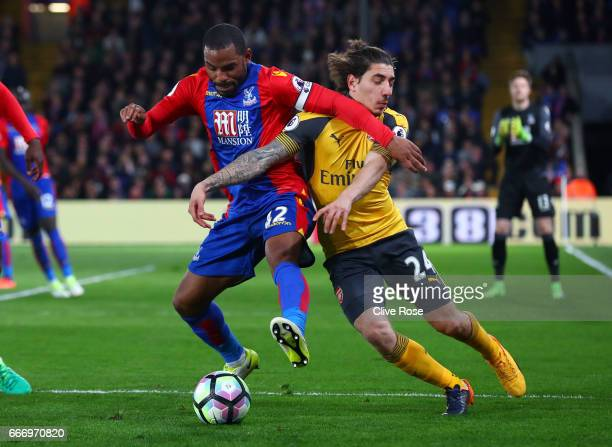 Jason Puncheon of Crystal Palace tussles with Hector Bellerin of Arsenal during the Premier League match between Crystal Palace and Arsenal at...