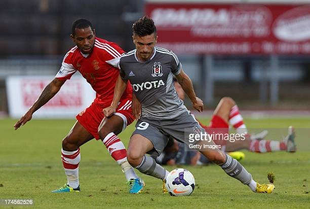 Jason Puncheon of Southampton and Gokhan Suzen of Bestikas compete for the ball during the preseason friendly match between Southampton FC and...