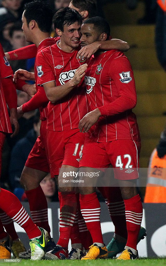 Jason Puncheon of Southampton (R) celebrates with team mate <a gi-track='captionPersonalityLinkClicked' href=/galleries/search?phrase=Jack+Cork+-+Soccer+Player&family=editorial&specificpeople=4206991 ng-click='$event.stopPropagation()'>Jack Cork</a> after scoring his team's second goal of the game during the Barclays Premier League match between Chelsea and Southampton at Stamford Bridge on January 16, 2013 in London, England.