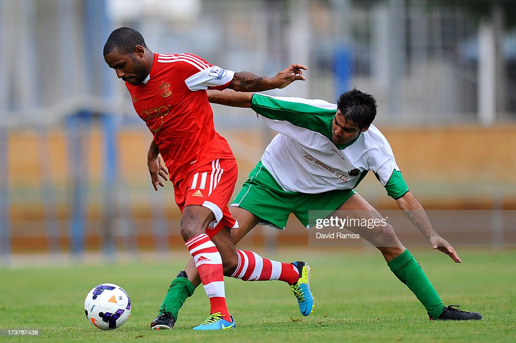 Jason Puncheon Southampton duels for the ball with Eloy Gila of UE Llagostera during a friendly match between Southampton FC and UE Llagostera at the Josep Pla i Arbones Stadium on July 17, 2013 in Girona, Spain.