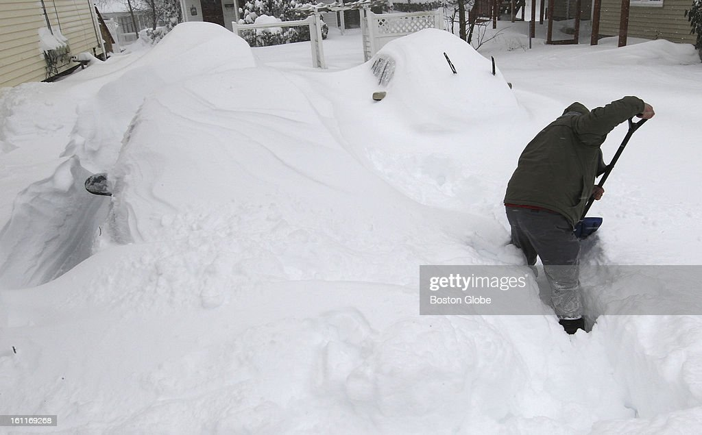 Jason Raymond digs out his car in Natick, Mass.