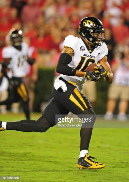 Jason Reese of the Missouri Tigers runs with a catch for a touchdown against the Georgia Bulldogs at Sanford Stadium on October 14 2017 in Athens...