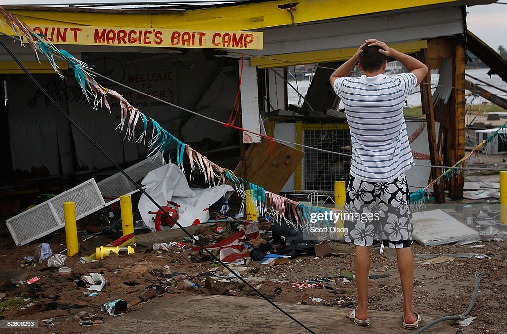 Jason Reuter surveys damage to his business which was destroyed by Hurricane Ike September 13 2008 in Galveston Texas Ike made landfall near...