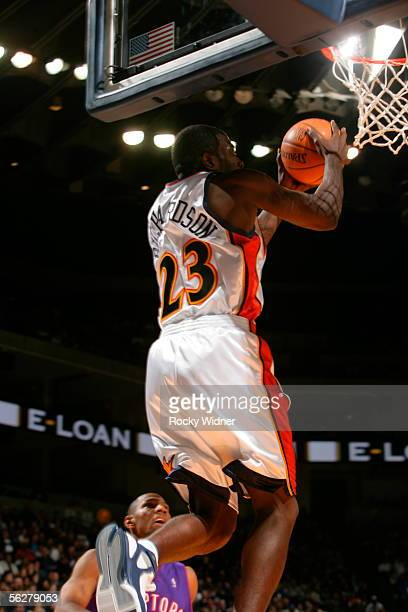 Jason Richardson of the Golden State Warriors slams home the alleyoop pass against the Toronto Raptors on November 26 2005 at the Arena in Oakland...