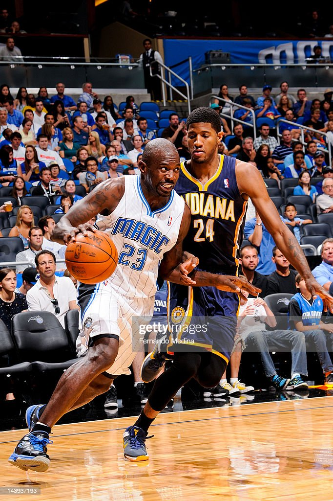 <a gi-track='captionPersonalityLinkClicked' href=/galleries/search?phrase=Jason+Richardson+-+Basketball+Player+-+Born+1981&family=editorial&specificpeople=201558 ng-click='$event.stopPropagation()'>Jason Richardson</a> #23 of the Orlando Magic drives against Paul George #24 of the Indiana Pacers in Game Four of the Eastern Conference Quarterfinals during the 2012 NBA Playoffs on May 5, 2012 at Amway Center in Orlando, Florida.
