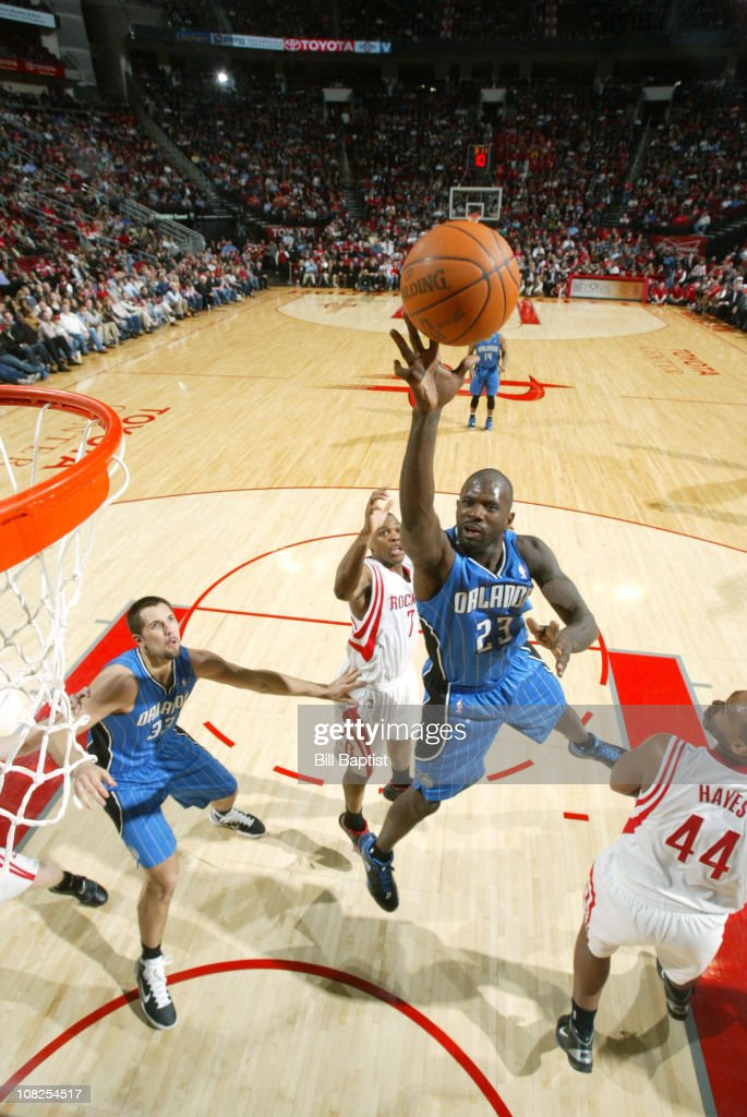 <a gi-track='captionPersonalityLinkClicked' href=/galleries/search?phrase=Jason+Richardson+-+Basketball+Player+-+Born+1981&family=editorial&specificpeople=201558 ng-click='$event.stopPropagation()'>Jason Richardson</a> #23 of the Orlando Magic shoots the ball over <a gi-track='captionPersonalityLinkClicked' href=/galleries/search?phrase=Kyle+Lowry&family=editorial&specificpeople=714625 ng-click='$event.stopPropagation()'>Kyle Lowry</a> #7 and <a gi-track='captionPersonalityLinkClicked' href=/galleries/search?phrase=Chuck+Hayes&family=editorial&specificpeople=206129 ng-click='$event.stopPropagation()'>Chuck Hayes</a> #44 of the Houston Rockets on January 22, 2011 at the Toyota Center in Houston, Texas.