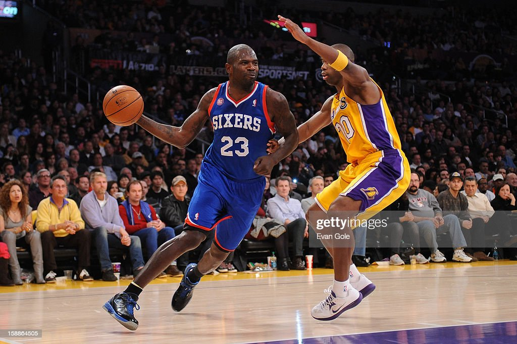 Jason Richardson #23 of the Philadelphia 76ers dribbles against Jodie Meeks #20 of the Los Angeles Lakers at Staples Center on January 1, 2013 in Los Angeles, California.