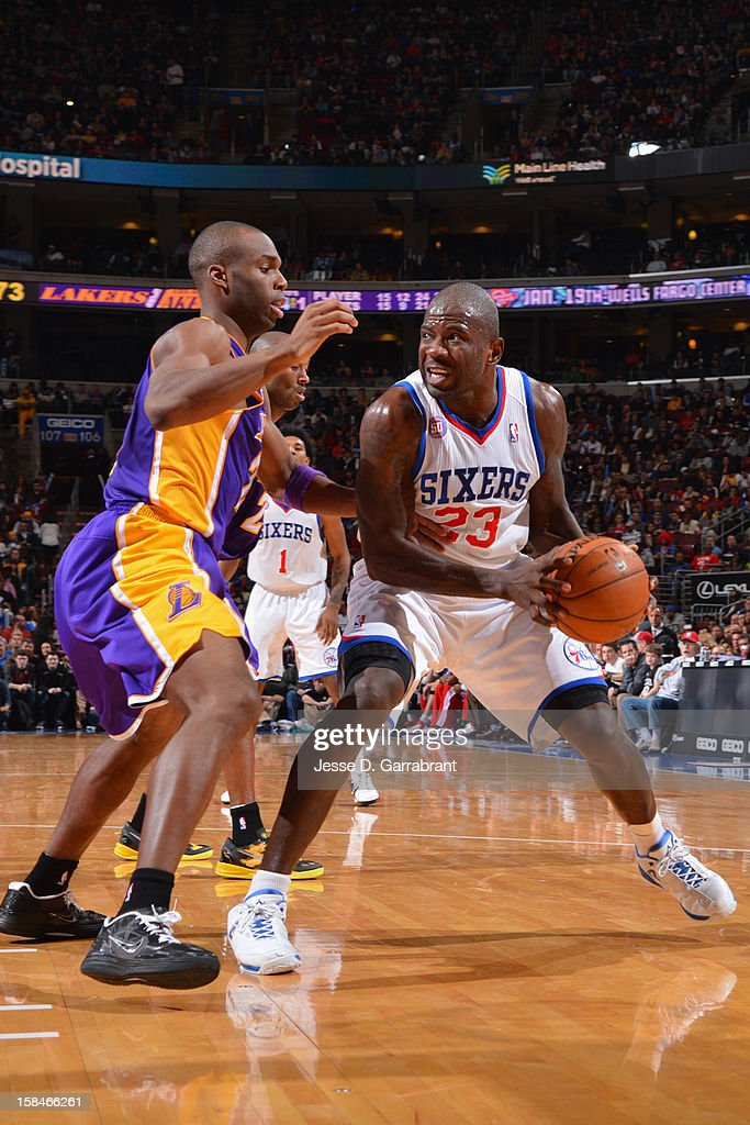 Jason Richardson #23 of the Philadelphia 76ers handles the ball against Jodie Meeks #20 of the Los Angeles Lakers on December 16, 2012 at the Wells Fargo Center in Philadelphia, Pennsylvania.