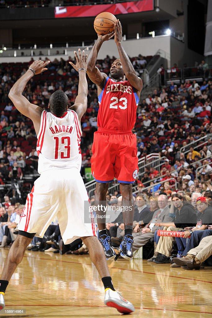 Jason Richardson #23 of the Philadelphia 76ers takes a shot over James Harden #13 of the Houston Rockets on December 19, 2012 at the Toyota Center in Houston, Texas.