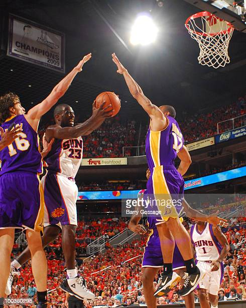 Jason Richardson of the Phoenix Suns drives for a shot between Pau Gasol and Andrew Bynum of the Los Angeles Lakers in Game Three of the Western...