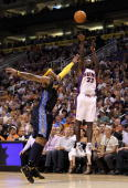 Jason Richardson of the Phoenix Suns puts up a shot over Carmelo Anthony of the Denver Nuggets during the NBA game at US Airways Center on April 13...