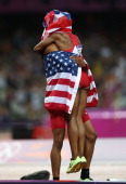 Jason Richardson of the United States hugs Carmelita Jeter of the United States after the Men's 110m Hurdles Final on Day 12 of the London 2012...