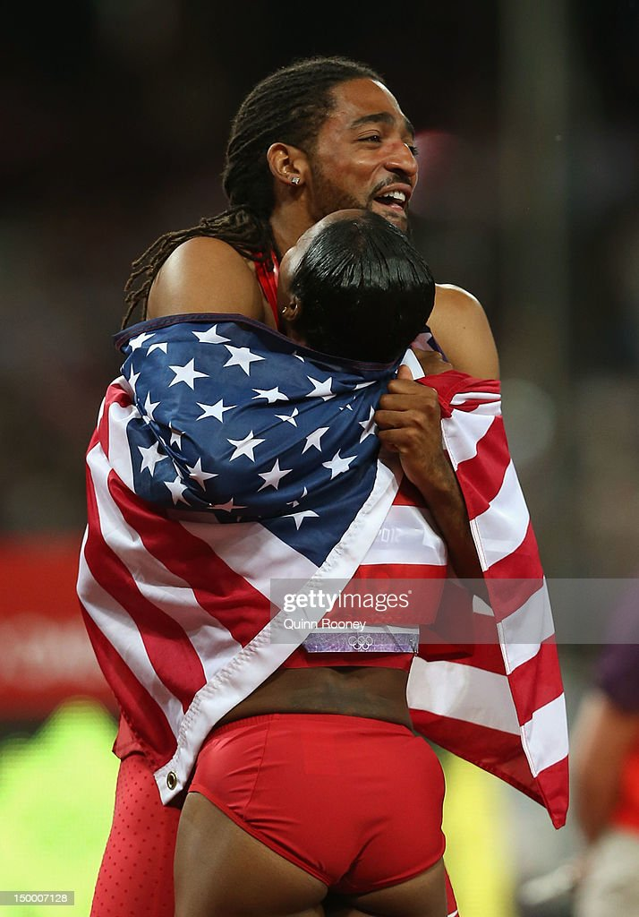 <a gi-track='captionPersonalityLinkClicked' href=/galleries/search?phrase=Jason+Richardson+-+Hurdler&family=editorial&specificpeople=15223987 ng-click='$event.stopPropagation()'>Jason Richardson</a> of the United States hugs <a gi-track='captionPersonalityLinkClicked' href=/galleries/search?phrase=Carmelita+Jeter&family=editorial&specificpeople=4472760 ng-click='$event.stopPropagation()'>Carmelita Jeter</a> of the United States after the Men's 110m Hurdles Final on Day 12 of the London 2012 Olympic Games at Olympic Stadium on August 8, 2012 in London, England.